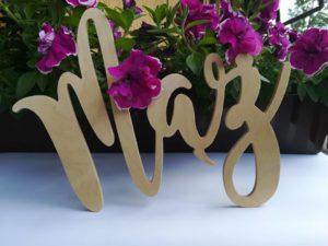 Drewniany napis mąż